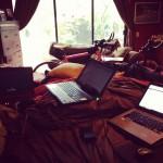 Laptop graveyard. Novels written on each: red -- MIssing Harmony, big silver -- Saving Grace, little slate -- Leaving Annalise.