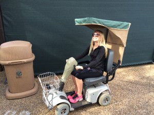 Susanne laughing and enjoying her cart.